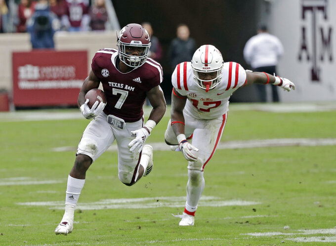 Texas A&M running back Jashaun Corbin (7) breaks away from Mississippi Rebels linebacker Willie Hibbler (17) during the second half of an NCAA college football game Saturday, Nov. 10, 2018, in College Station, Texas. Texas A&M won 38-24. (AP Photo/David J. Phillip)