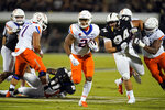 Boise State running back Andrew Van Buren, center, runs past Central Florida defensive lineman Anthony Montalvo (94) and linebacker Jeremiah Jean-Baptiste (11) for a touchdown during the first half of an NCAA college football game Thursday, Sept. 2, 2021, in Orlando, Fla. (AP Photo/John Raoux)