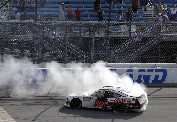 Cole Custer does a burnout after winning a NASCAR Xfinity Series auto race at Chicagoland Speedway in Joliet, Ill., Saturday, June 29, 2018. (AP Photo/Nam Y. Huh)