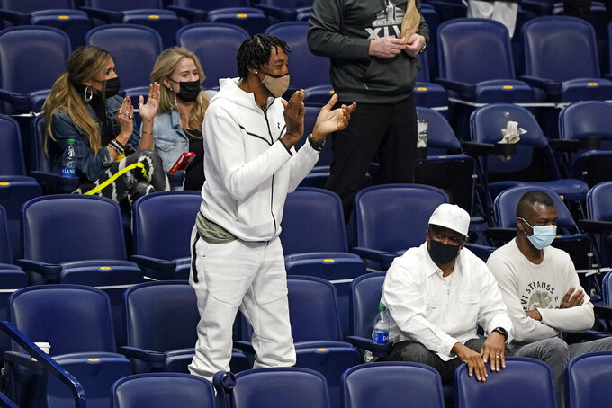 Former NBA star Scottie Pippen, center, stands and cheers during an NCAA college basketball game between Vanderbilt and Florida in the Southeastern Conference Tournament Thursday, March 11, 2021, in Nashville, Tenn. Pippen's son, Scotty Pippen Jr., plays for Vanderbilt. (AP Photo/Mark Humphrey)
