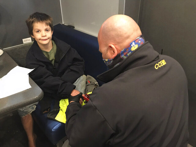 In this photo provided by the Tennessee Bureau of Investigation, 9-year-old Jordan Gorman is checked out by a Tennessee Bureau of Investigation employee after he was found in the woods near his home, Tuesday, Nov. 17, 2020, in Ashland City, Tenn. (Courtesy of Tennessee Bureau of Investigation via AP)