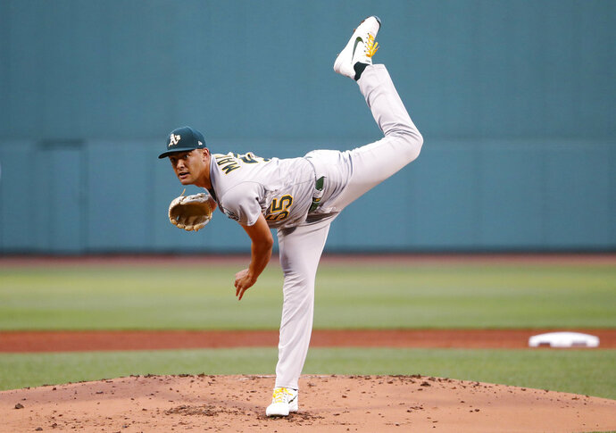 Oakland Athletics starting pitcher Sean Manaea delivers against the Boston Red Sox during the first inning of a baseball game at Fenway Park in Boston Monday, May 14, 2018. (AP Photo/Winslow Townson)