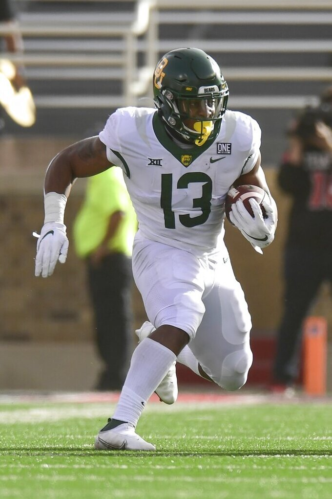 Baylor running back Qualan Jones (13) runs the ball against Texas Tech at an NCAA college football game in Lubbock, Texas, Saturday, Nov. 14, 2020. (AP Photo/Justin Rex)