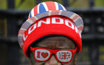 A pro-Brexit supporter wears Union flag decorated glasses and a hat as he demonstrates outside Parliament in London, Tuesday, Oct. 29, 2019. The leader of the U.K.'s opposition Labour Party told fellow lawmakers Tuesday that he'll back an early election for Britain now that the prospect of crashing out of the European Union without a deal has been taken off the table. The move by Jeremy Corbyn pushes the country closer to its first December election since 1923. (AP Photo/Kirsty Wigglesworth)