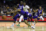 Kansas State guard Barry Brown Jr., front, reaches for a turnover with Baylor guard Devonte Bandoo, right, in the second half of an NCAA college basketball game, Saturday, Feb. 9, 2019, in Waco, Texas. (Rod Aydelotte/Waco Tribune Herald, via AP)