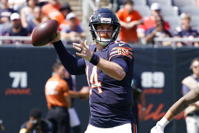 Chicago Bears quarterback Andy Dalton looks to pass during the first half of an NFL preseason football game against the Buffalo Bills Saturday, Aug. 21, 2021, in Chicago. (AP Photo/David Banks)