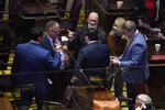 Rep. Johnny Garrett, R-Goodlettsville, top center, talks with other House members during a special session on education Thursday, Jan. 21, 2021, in Nashville, Tenn. (AP Photo/Mark Humphrey)