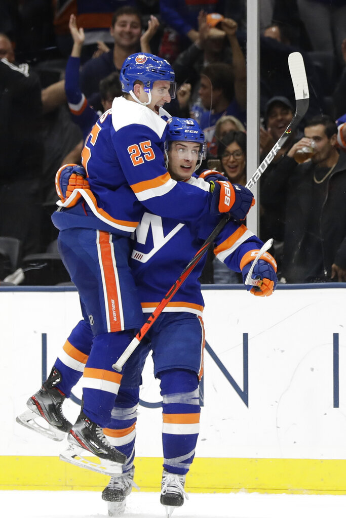 New York Islanders' Devon Toews (25) celebrates with Mathew Barzal (13) after Barzal scored a goal during the second period of an NHL hockey game against the Philadelphia Flyers, Sunday, Oct. 27, 2019, in Uniondale, N.Y. (AP Photo/Frank Franklin II)