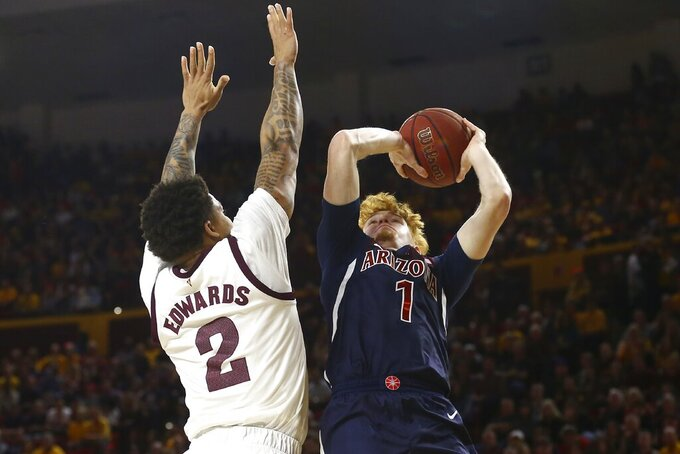 Arizona guard Nico Mannion (1) shoots over Arizona State guard Rob Edwards (2) during the first half of an NCAA college basketball game Saturday, Jan. 25, 2020, in Tempe, Ariz. (AP Photo/Ross D. Franklin)