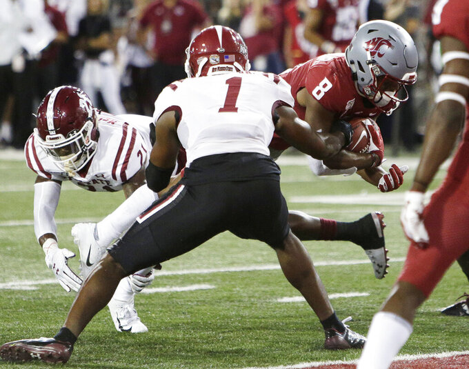 Washington State wide receiver Easop Winston Jr. (8) runs for touchdown between New Mexico State defensive backs Ray Buford Jr. (1) and Rodney McGraw II (21) during the first half of an NCAA college football game in Pullman, Wash., Saturday, Aug. 31, 2019. (AP Photo/Young Kwak)