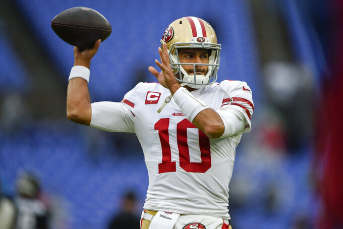San Francisco 49ers quarterback Jimmy Garoppolo warms up on the field before the start of an NFL football game against the Baltimore Ravens, Sunday, Dec. 1, 2019, in Baltimore, Md. (AP Photo/Gail Burton)