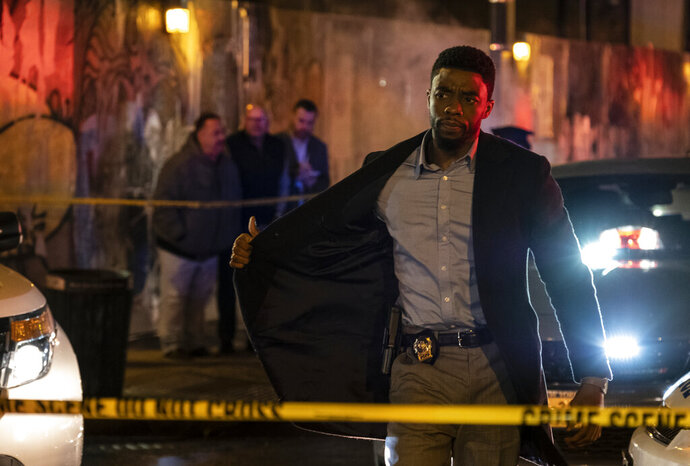 This image released by STXfilms shows Chadwick Boseman in a scene from