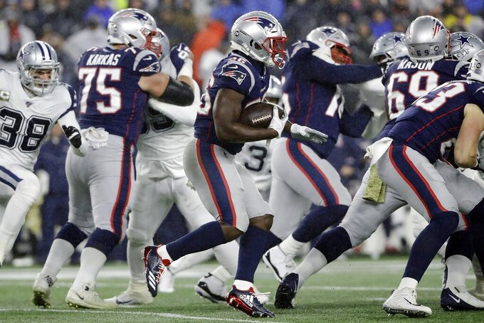New England Patriots running back Sony Michel carries the ball behind blockers in the first half of an NFL football game against the Dallas Cowboys, Sunday, Nov. 24, 2019, in Foxborough, Mass. (AP Photo/Steven Senne)