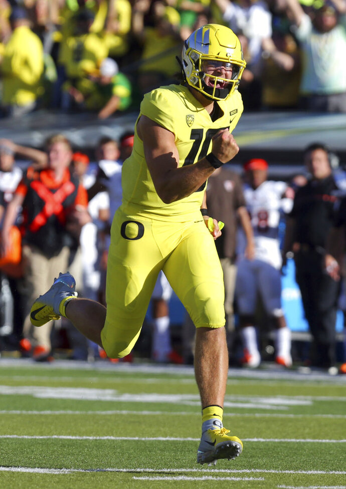 FILE - In this Sept. 1, 2018, file photo, Oregon's Justin Herbert celebrates a touchdown after connecting with wide receiver Jaylon Redd in the first half of an NCAA college football game against Bowling Green, in Eugene, Ore. or his first outing of the season, Oregon quarterback Justin Herbert had six touchdowns _ five via pass and one on the ground. There's a possibility that against Portland State on Saturday that he won't be in the game long enough to get as many. Or maybe not. (Andy Nelson/The Register-Guard via AP, File)