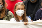 Swedish climate activist Greta Thunberg joins a Fridays for Future global climate strike in Berlin, Germany, Friday, Sept. 24, 2021. (AP Photo/Michael Sohn)