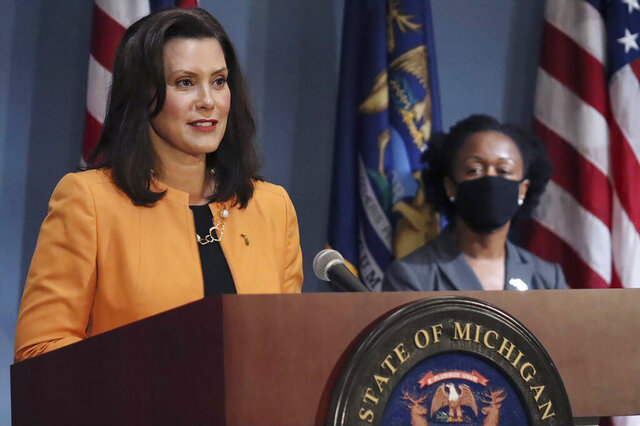 FILE - In this Aug. 19, 2020, file photo, provided by the Michigan Office of the Governor, Michigan Gov. Gretchen Whitmer addresses the state during a speech in Lansing, Mich. Gov. Whitmer on Wednesday, Sept, 23, 2020, called for Michigan to become