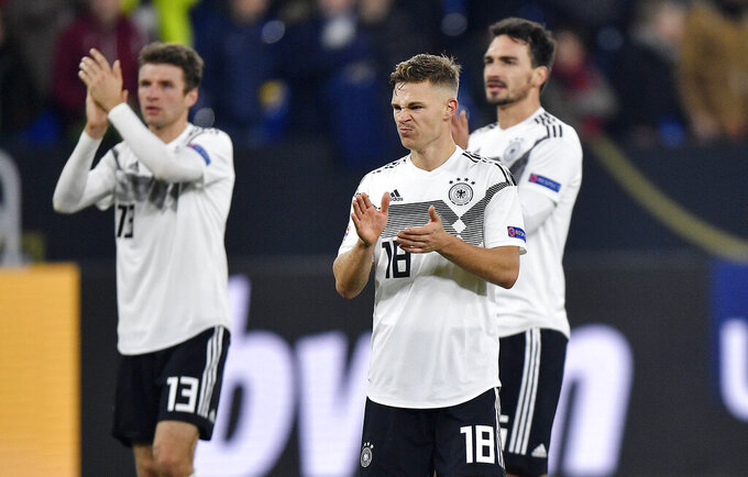 File - In this Monday, Nov. 19, 2018 file photo, German players Thomas Mueller, Joshua Kimmich and Mats Hummels, from left, claps hands to fans after the UEFA Nations League soccer match between Germany and The Netherlands in Gelsenkirchen. Thomas Mueller and Mats Hummels have been recalled by Germany coach Joachim Loew for the European Championship. Loew had dropped both players as part of his shakeup following the disappointing early exit from the 2018 World Cup. (AP Photo/Martin Meissner, file)