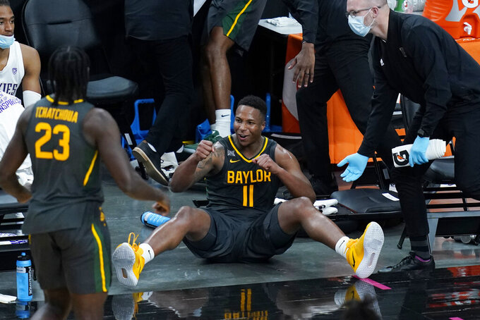Baylor's Mark Vital (11) celebrates after a play against Washington during the second half of an NCAA college basketball game Sunday, Nov. 29, 2020, in Las Vegas. (AP Photo/John Locher)