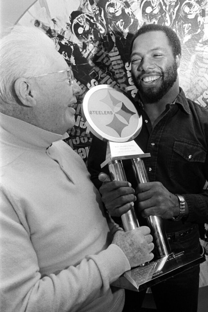 FILE - In this Dec. 16, 1980, file photo, Pittsburgh Steelers strong safety Donnie Shell, right, accepts the trophy for being named the Steelers' Most Valuable Player, from team vice president and chairman of the board Art Rooney, in Pittsburgh. Donnie Shell knew he was ahead of his time. It's why the Pittsburgh Steelers safety never worried about whether he'd get into the Hall of Fame. His long wait ended this week, when he got the call more than 30 years after playing his final game. (AP Photo/Gene Puskar, File)