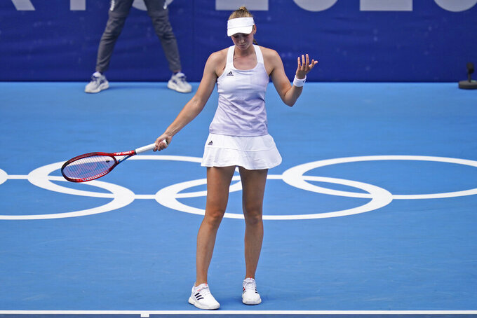 Elena Rybakina, of Kazakhstan, reacts while playing Belinda Bencic, of Switzerland, during the semifinals of the tennis competition at the 2020 Summer Olympics, Thursday, July 29, 2021, in Tokyo, Japan. (AP Photo/Seth Wenig)