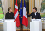Denmark's Prime Minister Mette Fredriksen, left, and French President Emmanuel Macron make declarations prior to a lunch at the Elysee Palace in Paris, Monday, Nov. 18, 2019. Denmark's Prime Minister Mette Fredriksen is in Paris for bilateral talks. (AP Photo/Michel Euler, Pool)