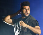 FILE - The Weeknd performs on day three at Lollapalooza in Chicago on Aug 4, 2018. The Weeknd, who was nominated for eight American Music Awards, was completely shut out of the Grammys, earning zero nominations despite having a No. 1 album. (Photo by Rob Grabowski/Invision/AP, File)