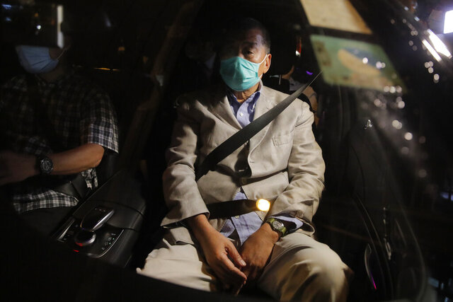Hong Kong media tycoon and newspaper founder Jimmy Lai, sits in a car as he leaves a police station after being bailed out in Hong Kong, Wednesday, Aug. 12, 2020. The rounding up of the paper's founder Jimmy Lai, the previous day and a raid on its headquarters have reinforced fears that a new national security law will be used to suppress dissent in Hong Kong after months of anti-government protests.(AP Photo/Kin Cheung)