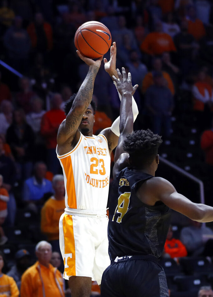 Tennessee guard Jordan Bowden (23) shoots over Alabama State forward Brandon Battle (14) during the first half of an NCAA college basketball game Wednesday, Nov. 20, 2019, in Knoxville, Tenn. (AP Photo/Wade Payne)