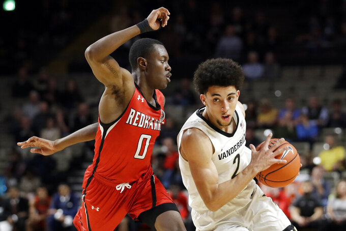 Vanderbilt guard Scotty Pippen Jr. (2) drives around Southeast Missouri State guard Alex Caldwell (0) in the second half of an NCAA college basketball game Wednesday, Nov. 6, 2019, in Nashville, Tenn. Vanderbilt won 83-65. (AP Photo/Mark Humphrey)
