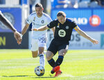 CF Montreal's Samuel Piette, right, challenges Chicago Fire's Stanislav Ivanov during first-half MLS soccer match action in Montreal, Sunday, Sept. 19, 2021. (Graham Hughes/The Canadian Press via AP)
