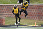 Missouri running back Larry Rountree III, right, celebrates with teammate Tyler Badie (1) after scoring on a 1-yard run during the second half of an NCAA college football game against Kentucky Saturday, Oct. 24, 2020, in Columbia, Mo. (AP Photo/L.G. Patterson)