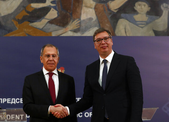 Russian Foreign Minister Sergey Lavrov, left, shakes hands with Serbia's President Aleksandar Vucic after a joint press conference in Belgrade, Serbia, Thursday, June 18, 2020. Lavrov is on a two-day official visit to Serbia. (AP Photo/Darko Vojinovic)