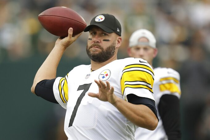 Pittsburgh Steelers' Ben Roethlisberger warms up before an NFL football game against the Green Bay Packers Sunday, Oct. 3, 2021, in Green Bay, Wis. (AP Photo/Matt Ludtke)