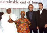 In this Sept. 27, 1990 file photo actor Raúl Juliá, far right, next to actor Peter Weller, pose with Gen. Olusegun Obasanjo, left, former president of Nigeria, and Esther Afua Ocloo, second from left, of Ghana, at the Africa Prize for Leadership for the Sustainable End of Hunger at the New York Hilton Hotel. Juliá, who opened doors from a generation of Latino artists to in film and television, is the subject of a new documentary scheduled to air on PBS on Friday, Sept 13, 2019. (AP Photo/Susan Ragan,File)