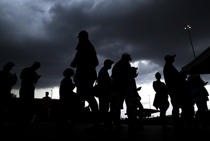Fans attend a NASCAR Cup Series auto race at Chicagoland Speedway in Joliet, Ill., Sunday, June 30, 2019. Sunday's Monster Energy NASCAR Cup Series race at Chicagoland Speedway was delayed by inclement weather. (AP Photo/Nam Y. Huh)