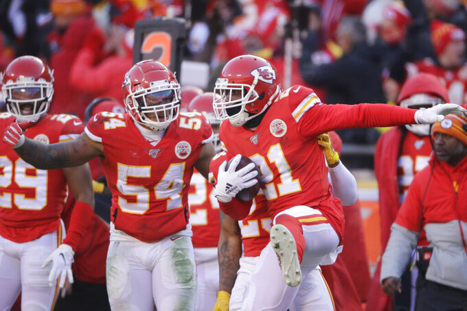 Kansas City Chiefs' Bashaud Breeland (21) celebrates after an interception during the first half of the NFL AFC Championship football game against the Tennessee Titans Sunday, Jan. 19, 2020, in Kansas City, MO. (AP Photo/Charlie Riedel)
