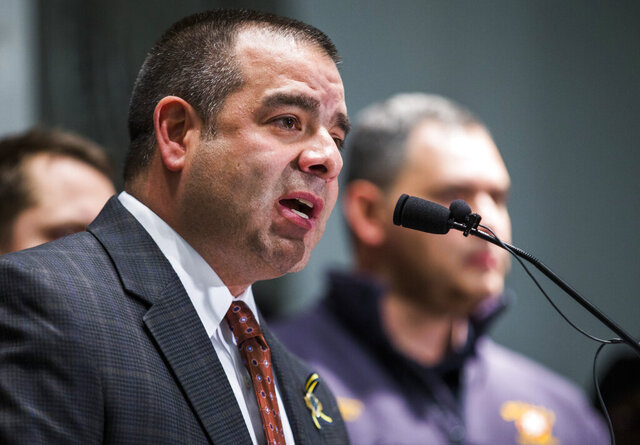 Dallas Police Sergeant Mike Mata, president of the Dallas Police Association, announces to the media that pension negotiations between police and fire associations and the city of Dallas have failed, in a Thursday, January 26, 2017 photo, at the Dallas Police Association headquarters in Dallas. A Texas grand jury will not indict Mata, accused of tampering with evidence in the case of a white Dallas police officer who fatally shot her unarmed Black neighbor. (Ashley Landis/The Dallas Morning News via AP)