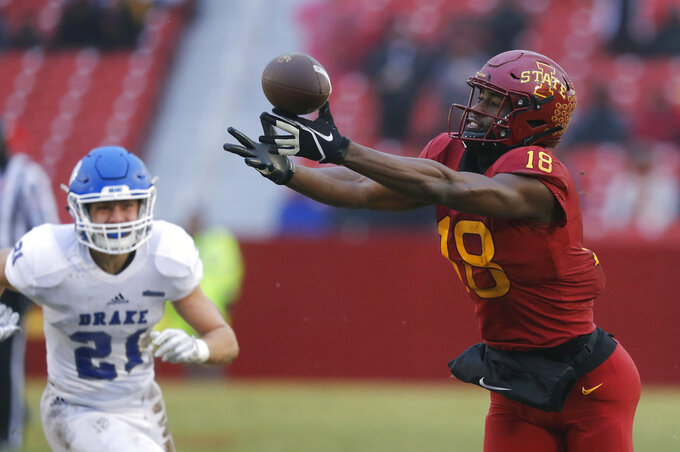 Iowa State wide receiver Hakeem Butler tries to make a reception in front of Drake defensive back Will Warner, left, during the first half of an NCAA college football game, Saturday, Dec. 1, 2018, in Ames, Iowa. The pass fell incomplete. (AP Photo/Charlie Neibergall)