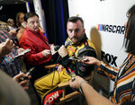 Austin Dillon, center, talks with reporters during the NASCAR Daytona 500 auto racing media day at Daytona International Speedway, Wednesday, Feb. 13, 2019, in Daytona Beach, Fla. (AP Photo/John Raoux)