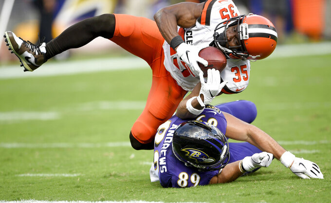 Cleveland Browns defensive back Jermaine Whitehead (35) intercepts a pass from Baltimore Ravens quarterback Lamar Jackson, not visible, intended for tight end Mark Andrews (89) during the second half of an NFL football game Sunday, Sept. 29, 2019, in Baltimore. (AP Photo/Nick Wass)