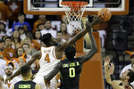 Texas forward Mohamed Bamba (4) and Baylor forward Jo Lual-Acuil Jr. (0) battle for a rebound during the first half of an NCAA college basketball game, Monday, Feb. 12, 2018, in Austin, Texas. (AP Photo/Eric Gay)