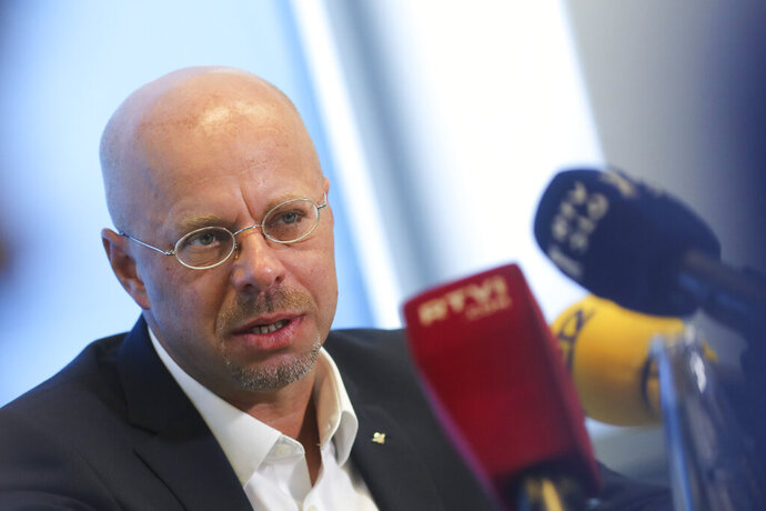 Andreas Kalbitz the Alternative for Germany, AfD, top candidate for the regional election in the German state of Brandenburg attends a news conference in Berlin, Germany, Tuesday, Aug. 13, 2019. On Sunday Sept.1, 2019 regional state elections will take place in the eastern German state of Brandenburg. (AP Photo/Markus Schreiber)