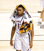 Virginia guard Casey Morsell (13) walks off the court after the team's loss to Ohio in a first-round game in the NCAA men's college basketball tournament, Saturday, March 20, 2021, at Assembly Hall in Bloomington, Ind. (AP Photo/Doug McSchooler)