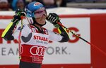 United States' Mikaela Shiffrin celebrates her third place after completing an alpine ski, women's World Cup giant slalom, in Spindleruv Mlyn, Czech Republic, Friday, March. 8, 2019. (AP Photo/Giovanni Auletta)