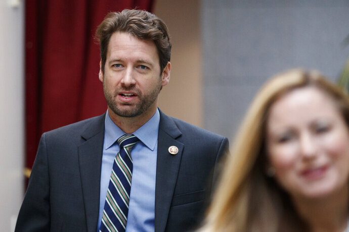 FILE - In this Jan. 4, 2019, file photo, Rep. Joe Cunningham, D-S.C., walks to a closed Democratic Caucus meeting on Capitol Hill in Washington. Virtually all of the Democratic presidential hopefuls have reached out to Cunningham who flipped a House seat in early-voting, conservative South Carolina. Democrats hoping to unseat President Donald Trump in 2020 are dancing with the freshman stars these days in an unprecedented pursuit of still-green lawmakers in an institution driven by seniority. (AP Photo/Carolyn Kaster, File)