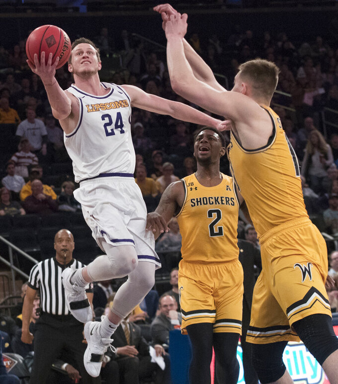 Lipscomb guard Garrison Mathews (24) goes to the basket against Wichita State guard Jamarius Burton (2) and guard Erik Stevenson (10) during the first half of a semifinal college basketball game in the National Invitational Tournament, Tuesday, April 2, 2019, at Madison Square Garden in New York. (AP Photo/Mary Altaffer)