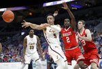 Loyola of Chicago's Marques Townes (5) passes as Bradley's Luqman Lundy (2) and Luuk van Bree (13) defend during the first half of an NCAA college basketball game in the semifinal round of the Missouri Valley Conference tournament, Saturday, March 9, 2019, in St. Louis. (AP Photo/Jeff Roberson)