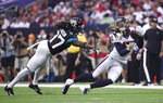 Houston Texans wide receiver Will Fuller (15) makes a catch in front of Jacksonville Jaguars cornerback Tre Herndon (37) during the first half of an NFL football game Sunday, Sept. 15, 2019, in Houston. (AP Photo/Eric Christian Smith)