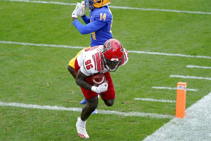 North Carolina State wide receiver Emeka Emezie (86) makes a catch for a touchdown past Pittsburgh Panthers defensive back Marquis Williams (14) in the first half of an NCAA college football game, Saturday, Oct. 3, 2020, in Pittsburgh. (AP Photo/Keith Srakocic)