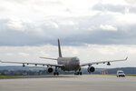 In this image provided by the U.S. Air Force, a Singapore Air Force A330 Multi-Role Tanker Transport aircraft taxis on the runway of Spangdahlem Air Base, Germany, on Friday, Aug. 27, 2021. The Singapore Armed Forces is working alongside partners like the United States in order to provide a safe and secure passage for displaced families and evacuees from Afghanistan. (Tech. Sgt. Maeson L. Elleman/U.S. Air Force via AP)